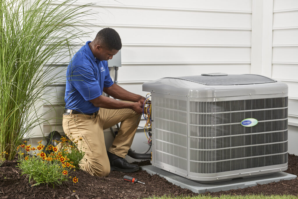 HVAC techs check AC outdoor cooling unit.